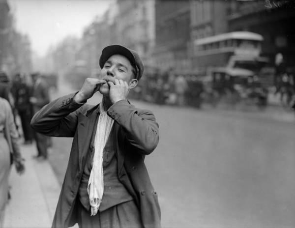 Reportage Photograph - Street Whistler by Fox Photos