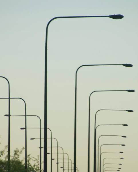 Streetlights Against Afternoon Sky Art Print by By Ken Ilio