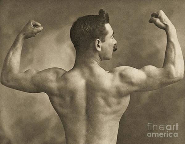 Wall Art - Photograph - Strongman Striking Rear Double Bicep Pose, Circa 1910  by English School