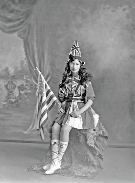 Painting - Studio Portrait Of Unidentified Girl, Dressed In Union Jack Flags And Holding An American Flag, Prob by Adam MacLay