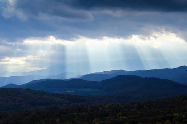 Photograph - Light Breaking Through Clouds by Paul Croll