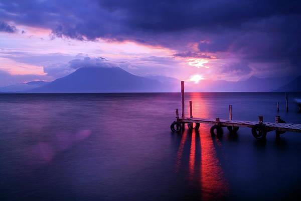 Setting Photograph - Sun Setting On Lake Atitlan, With by Sean Caffrey