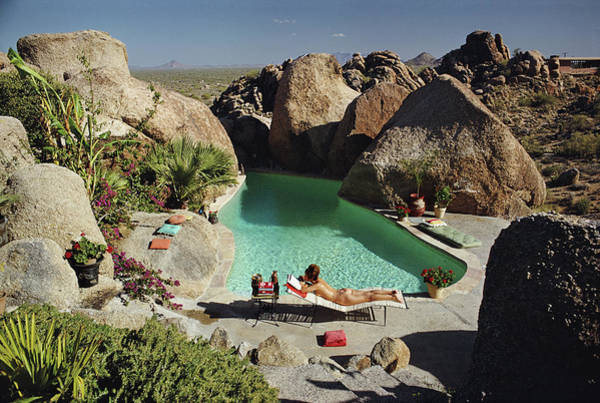 Swimming Pool Photograph - Sunbathing In Arizona by Slim Aarons