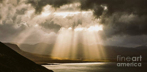 Photograph - Sunbeams Fall Among The Clouds In A Lake Between Mountains. by Joaquin Corbalan