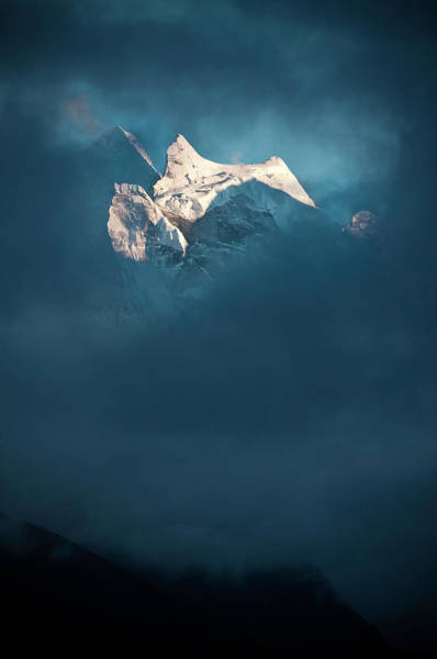 Khumbu Wall Art - Photograph - Sunlit Snow Himalaya Peak Dark Swirling by Fotovoyager