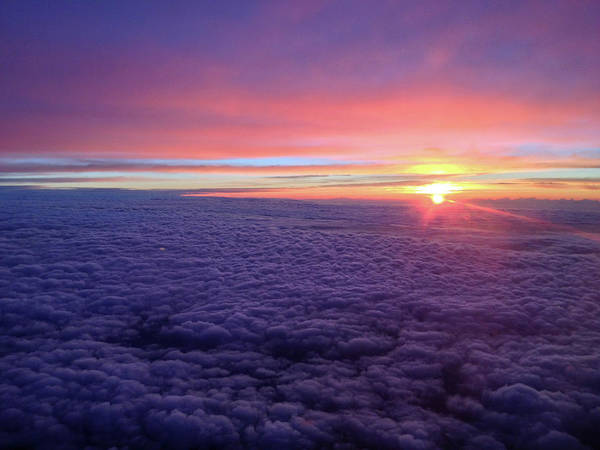 Photograph - Sunrise Above The Clouds by Mark Duehmig