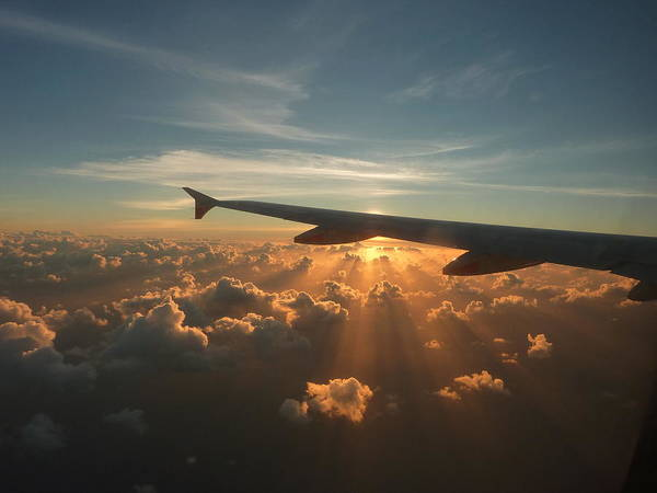Wall Art - Photograph - Sunrise At 35,000ft by E Woolley