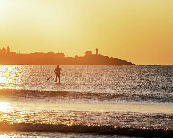 Photograph - Sunrise Paddle Boarder Paddling By The Nubble Lighthouse From Long Sands Beach Long Beach York Maine by Toby McGuire