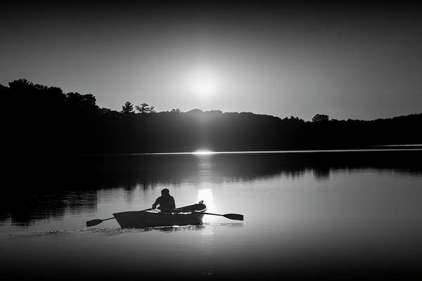 Wall Art - Photograph - Sunrise With Rowboat Crossing Stony Lake In Black And White by Randall Nyhof
