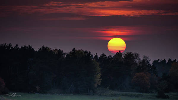 Photograph - Sunset At An Hazy Evening by Torbjorn Swenelius