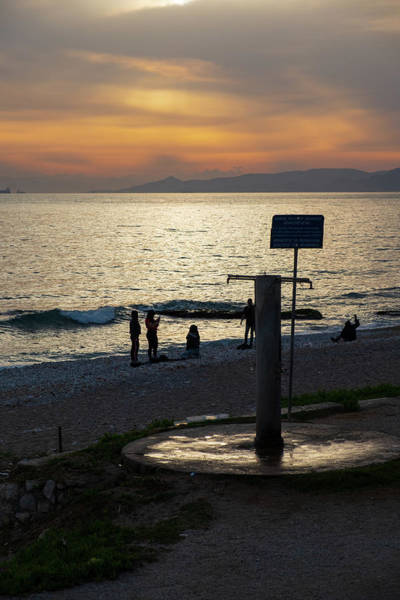 Photograph - Sunset At Paleo Faliro Beach by Iordanis Pallikaras