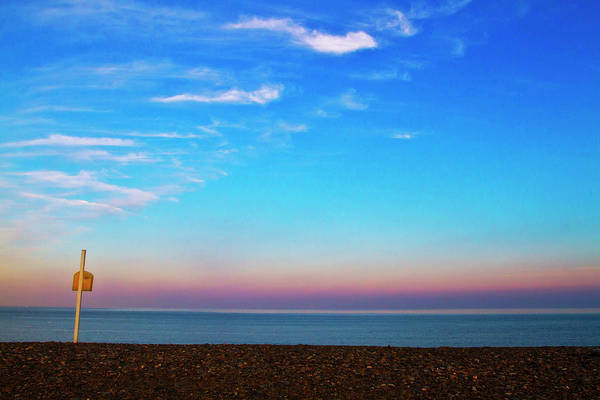 Photograph - Sunset On Empty Beach With Lifebouy On by Image By Catherine Macbride