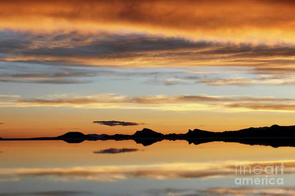 Photograph - Sunset Reflections Salar De Uyuni Bolivia by James Brunker