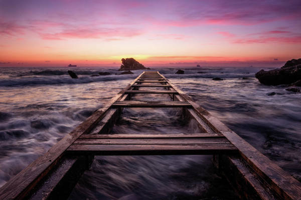 Photograph - Sunset Shining Over A Wooden Pier In Livorno, Tuscany by Matteo Viviani
