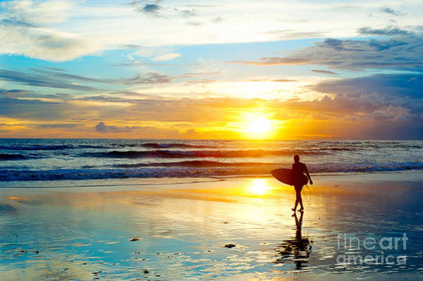 Surfer On The Ocean Beach At Sunset On Art Print