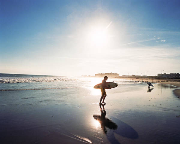 Rockaway Photograph - Surfers On Beach Leaving Water, Sunset by Diane Cook And Len Jenshel