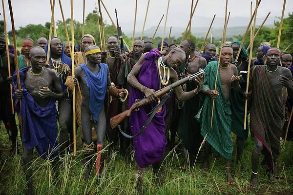 Shaved Head Photograph - Suri Tribal Warriors, Sticks & Guns At by Timothy Allen