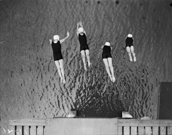 Photograph - Synchronized Dive by Fox Photos