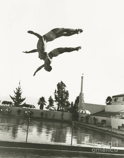 Caucasian Wall Art - Photograph - Synchronized Divers In Mid-air by Everett Collection