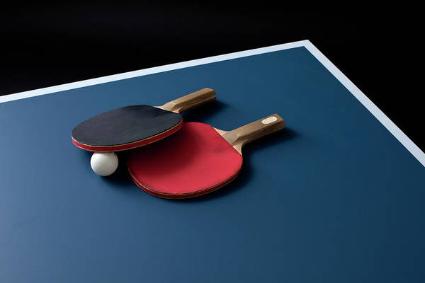 Table Photograph - Table Tennis Bats And A Ball On A Table by Benne Ochs
