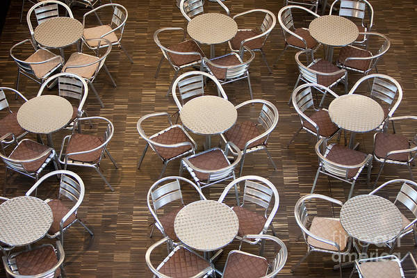 Wall Art - Photograph - Tables And Chairs In A Restaurant by Danielw
