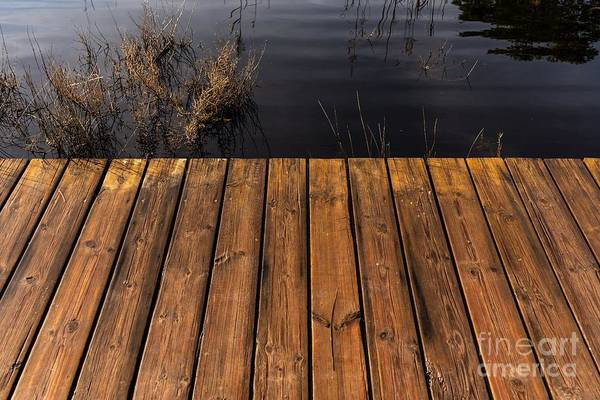 Photograph - Tables Of A Wet Wooden Bridge Over A Lake. by Joaquin Corbalan