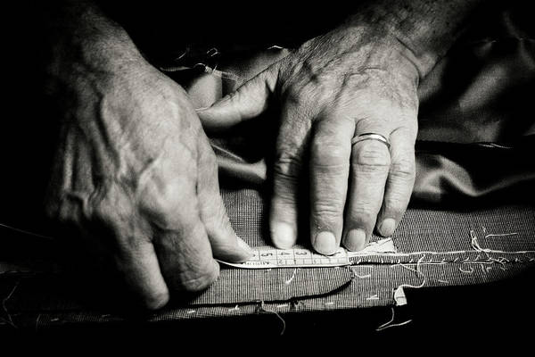 Craftsperson Photograph - Tailor At Work by Gmalandra