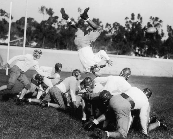 American Football Photograph - Taken A Tumble by American Stock Archive