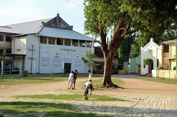 Photograph - Tamil Boys Play Football In Compound Of St Mary's Cathedral Catholic Church Jaffna Sri Lanka by Imran Ahmed