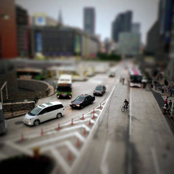 Wall Art - Photograph - Taxis, Bus, Cars, And A Bike Going In by Takahiro Yamamoto
