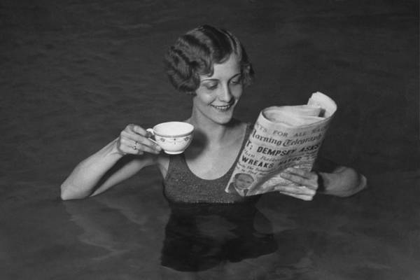 Newspaper Photograph - Tea In The Pool by Hulton Collection