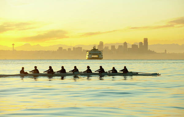 Rowing Photograph - Team Rowing Boat In Bay by Pete Saloutos