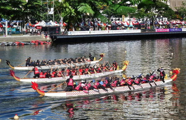 Photograph - Teams Compete In The Dragon Boat Races by Yali Shi