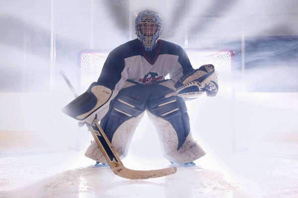 Competitive Sport Photograph - Teenage 14-16 Hockey Goalie In Front Of by B Busco