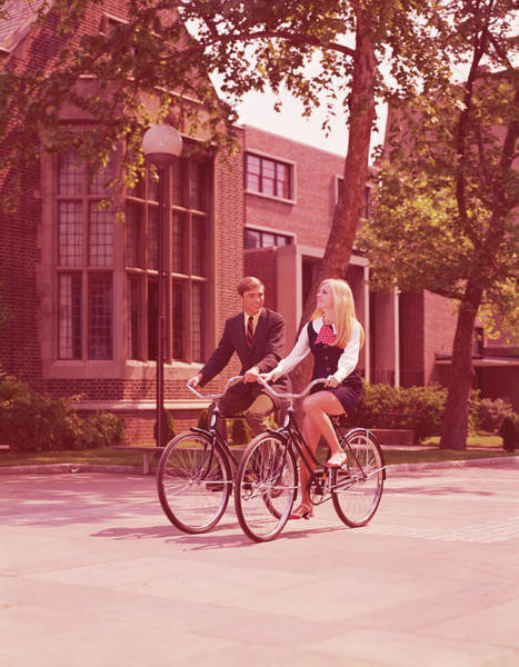 Heterosexual Couple Photograph - Teenage Couple Riding Bicycles Past by H. Armstrong Roberts