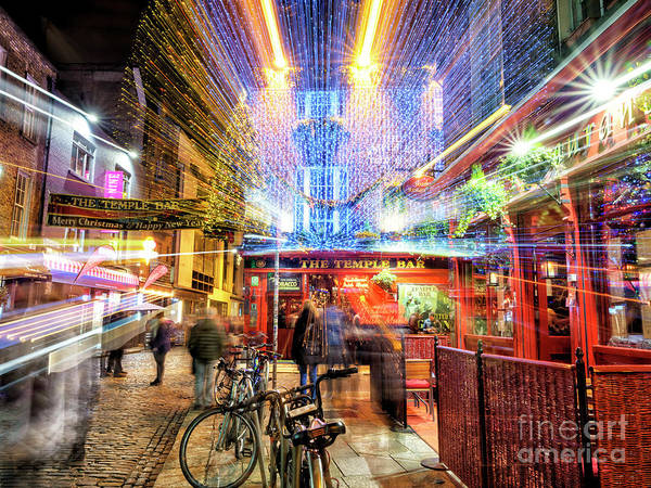 Wall Art - Photograph - Temple Bar Light Motion 4 In Dublin by John Rizzuto