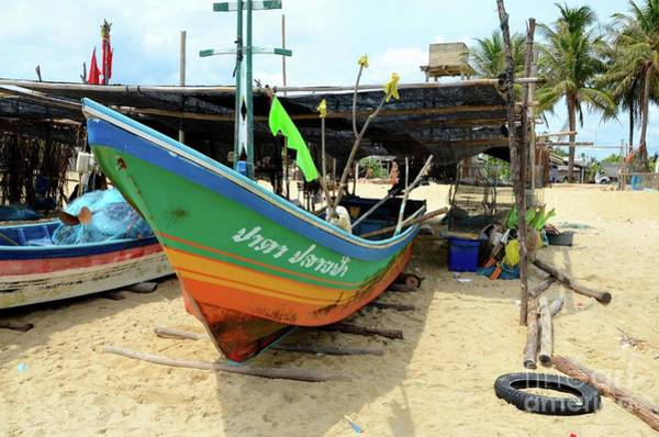 Photograph - Thai Fishing Boat Bow Parked On Logs On Beach Sand At Village In Pattani Thailand by Imran Ahmed