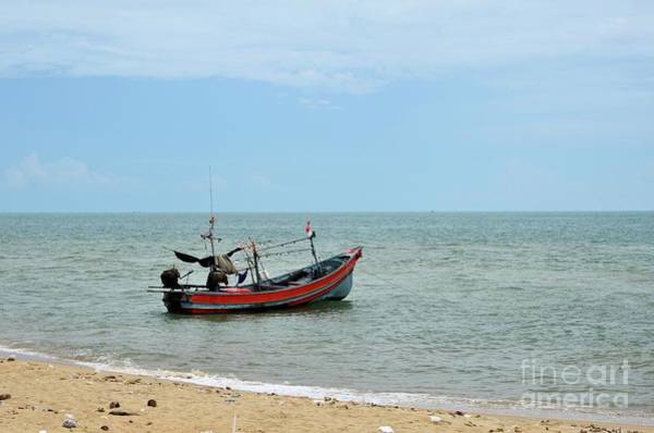 Photograph - Thai Fishing Boat With Motor Parked At Sea By Beach In Pattani Fishing Village Thailand by Imran Ahmed