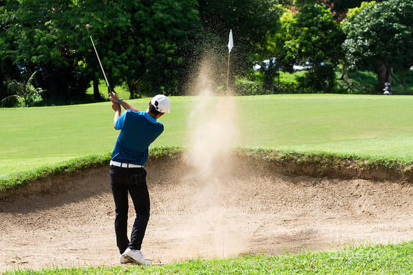 Wall Art - Photograph - Thai Young Man Golf Player In Action by Kitzero