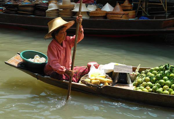 Wall Art - Photograph - Thailand, Bangkok, Woman Steering Boat by Steve Allen