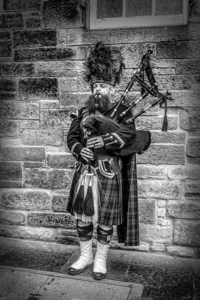 Holyrood Photograph - The Bagpiper In Full Dress In Black And White by Debra and Dave Vanderlaan