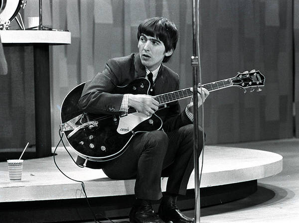 Harrison Photograph - The Beatles 1964 Us Tour. Guitarist by Popperfoto