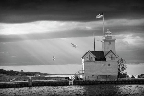 Photograph - The Big Red Lighthouse In Black And White With Sunbeams On Lake  by Randall Nyhof