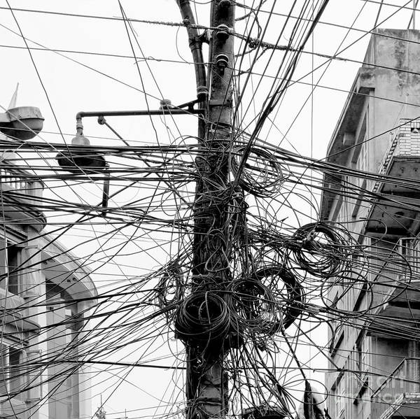 Current Photograph - The Chaos Of Cables And Wires In by Vadim Petrakov