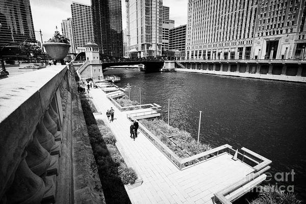 Wall Art - Photograph - The Chicago Riverwalk Across From Merchandise Mart On The Chicago River Chicago Illinois United Stat by Joe Fox