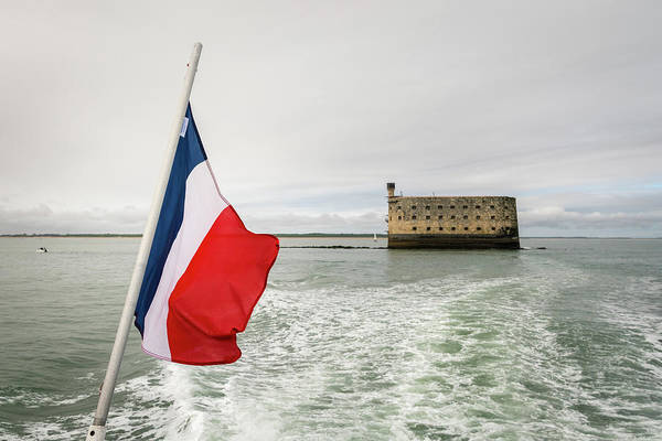 Photograph - The Flag Of France With A Sea Fortress In The Background by Stefan Rotter