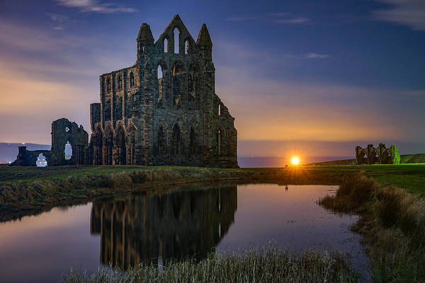 Wall Art - Photograph - The Historic Whitby Abbey In England Seen On A Beautiful Night. by George Afostovremea
