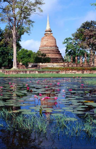 Wall Art - Photograph - The Lotus Pond And Familiar Chedi Or by Glenn Beanland