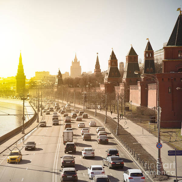 Riverside Wall Art - Photograph - The Moscow Kremlin And Road Traffic by Roman Sigaev