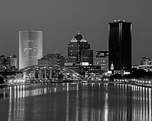 Photograph - The Rochester Skyline Reflecting The The Genesee River Rochester Ny Blue Building Black And White by Toby McGuire